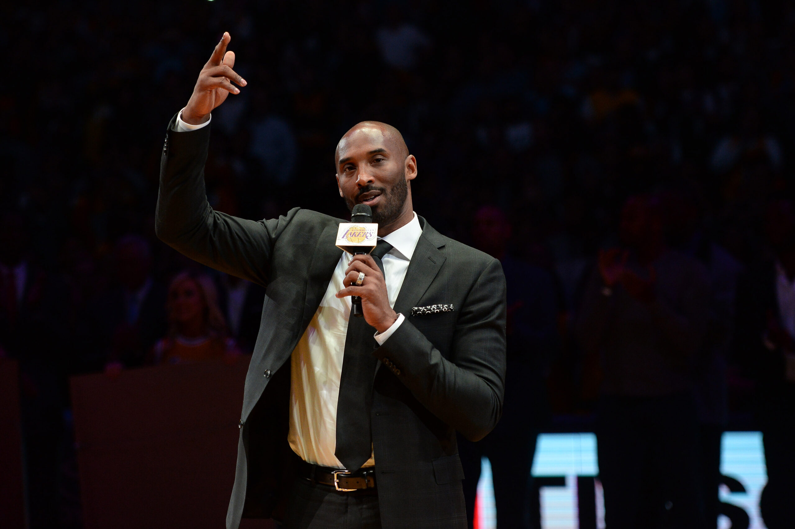 Kobe Bryant speaks during a ceremony to retire both the numbers he wore as a Los Angeles Laker at the Staples Center in Los Angeles