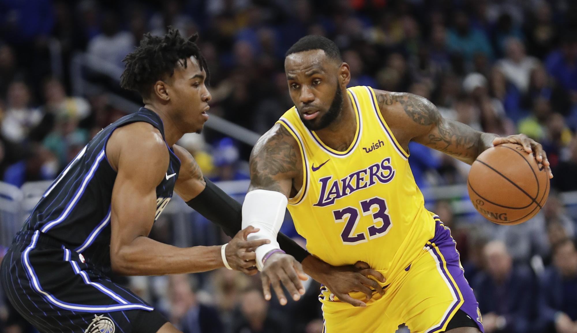 LeBron James and Wes Iwundu, Los Angeles Lakers vs Orlando Magic
