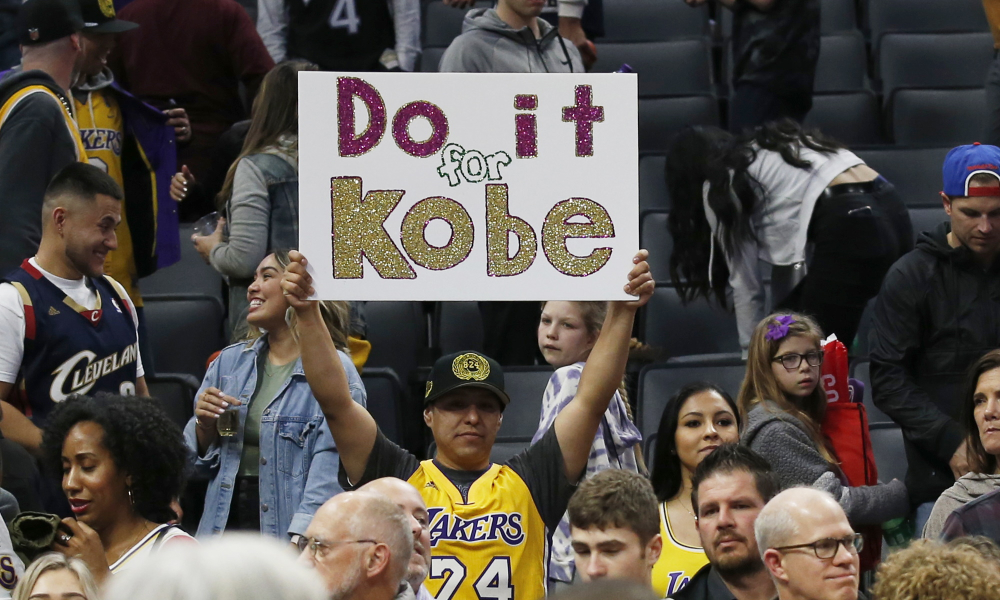 A Los Angeles Lakers fan displays a sign in memory of Kobe Bryant, Los Angeles Lakers vs Sacramento Kings at Golden 1 Center