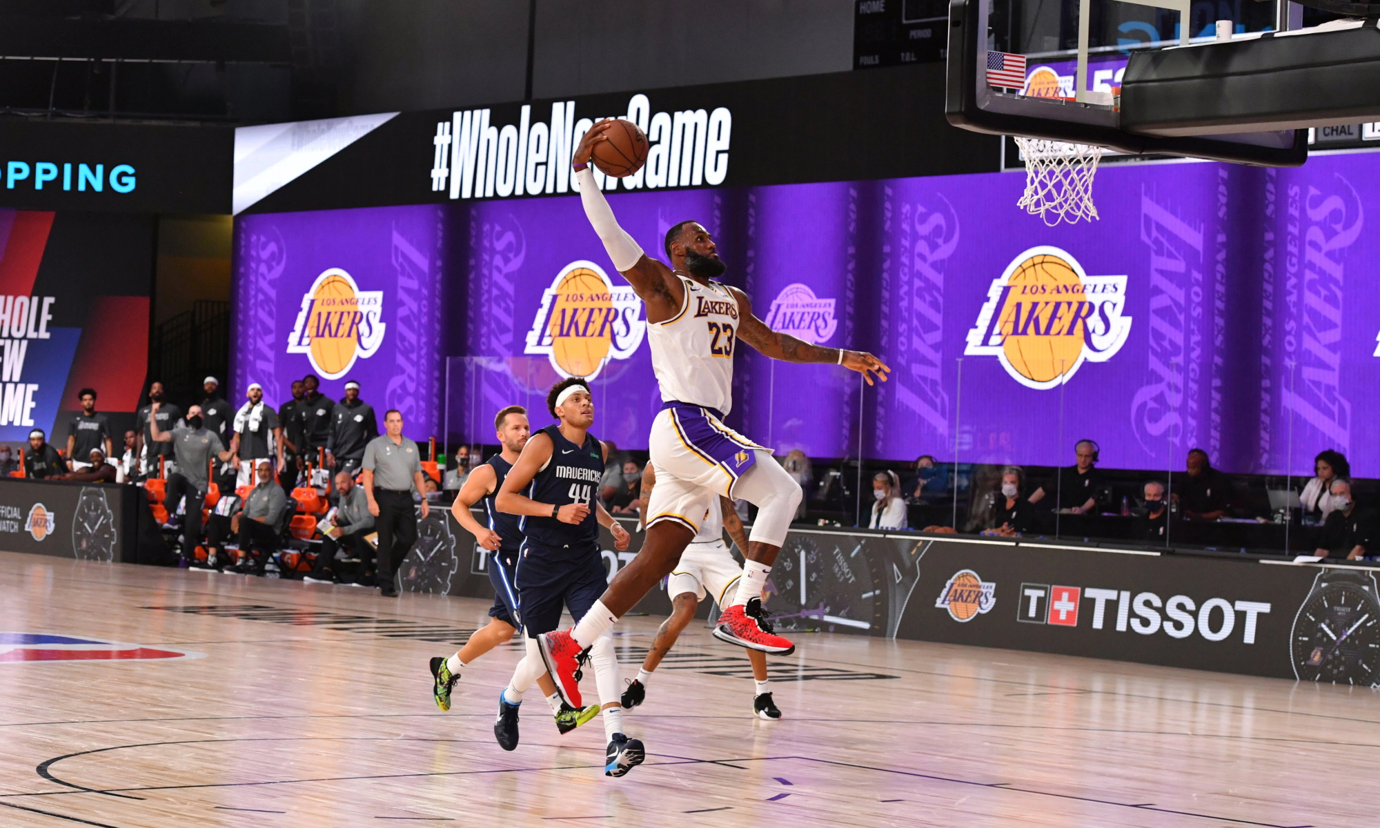 LeBron James #23 of the Los Angeles Lakers dunks the ball against the Dallas Mavericks on July 23, 2020 at the Visa Athletic Center at ESPN Wide World of Sports Complex in Orlando, Florida.