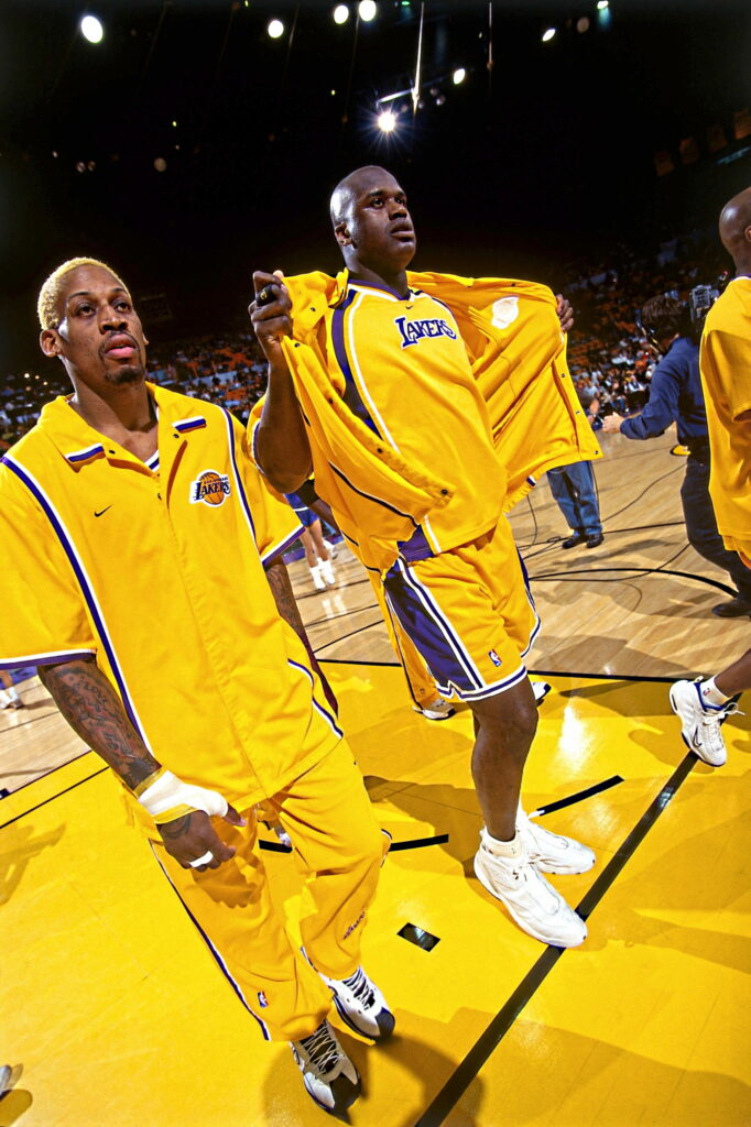 Dennis Rodman #73 and Shaquille O'Neal #34 of the Los Angeles Lakers before a game in 1999 at Great Western Forum in Los Angeles, California.