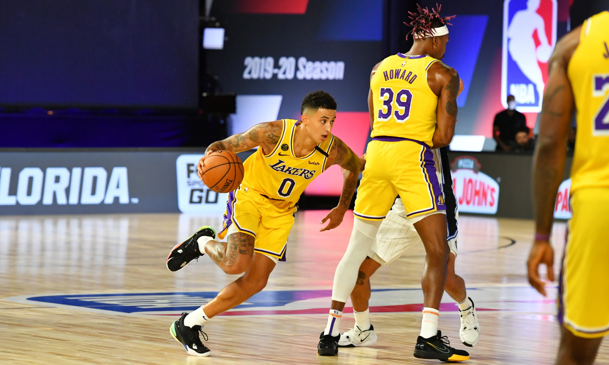Kyle Kuzma #0 of the Los Angeles Lakers handles the ball against the Orlando Magic during a scrimmage on July 25, 2020 at HP Field House at ESPN Wide World of Sports in Orlando, Florida.