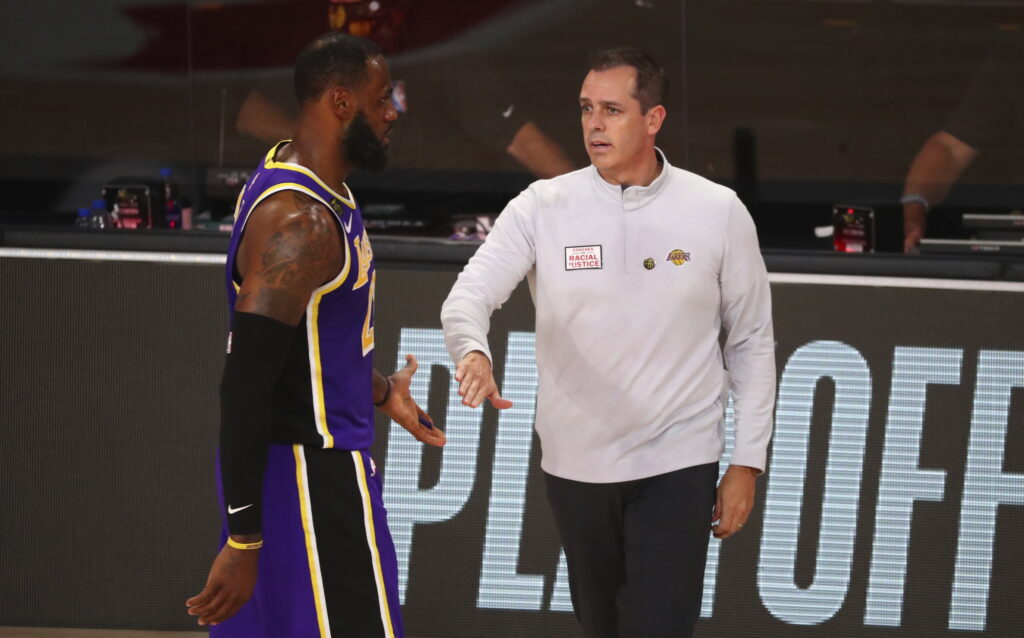 Los Angeles Lakers forward LeBron James (23) slaps hands with head coach Frank Vogel in the second half of Game 3 of an NBA basketball first-round playoff series against the Portland Trail Blazers, Saturday, Aug. 22, 2020, in Lake Buena Vista, Fla.