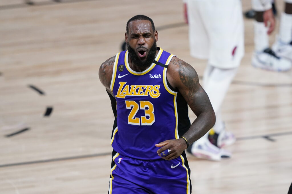Los Angeles Lakers forward LeBron James (23) celebrates a play during the first half of an NBA basketball first round playoff game against the Portland Trail Blazers, Saturday, Aug. 22, 2020, in Lake Buena Vista, Fla.