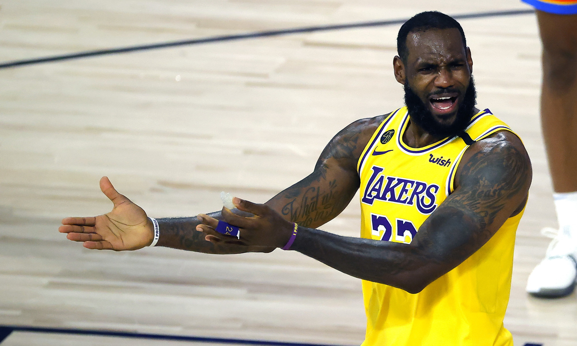 LeBron James of the Los Angeles Lakers reacts to a call against the Oklahoma City Thunder during the second half of an NBA basketball game Wednesday, Aug. 5, 2020, in Lake Buena Vista, Fla.