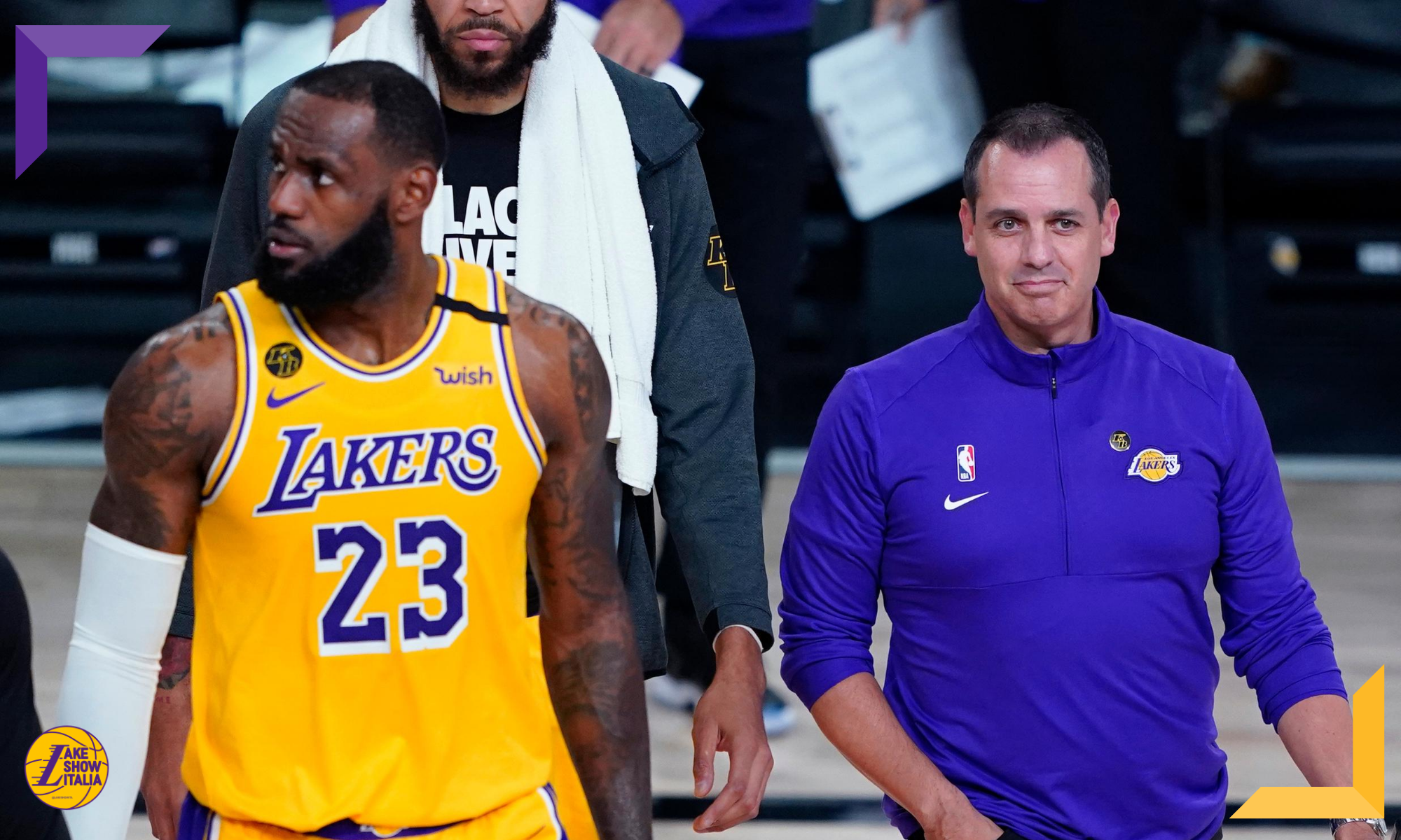 Los Angeles Lakers head coach Frank Vogel and forward LeBron James walk on the court during a timeout due to a goal being knocked out of position during the first half of an NBA basketball game against the Portland Trail Blazers Tuesday, Aug. 18, 2020, in Lake Buena Vista, Fla.