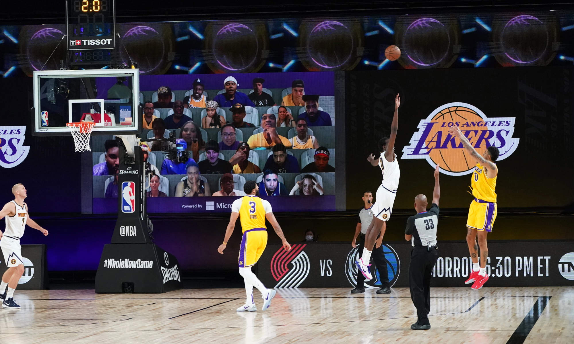 Kyle Kuzma #0 of the Los Angeles Lakers shoots a three-pointer to win the game against the Denver Nuggets on August 10, 2020