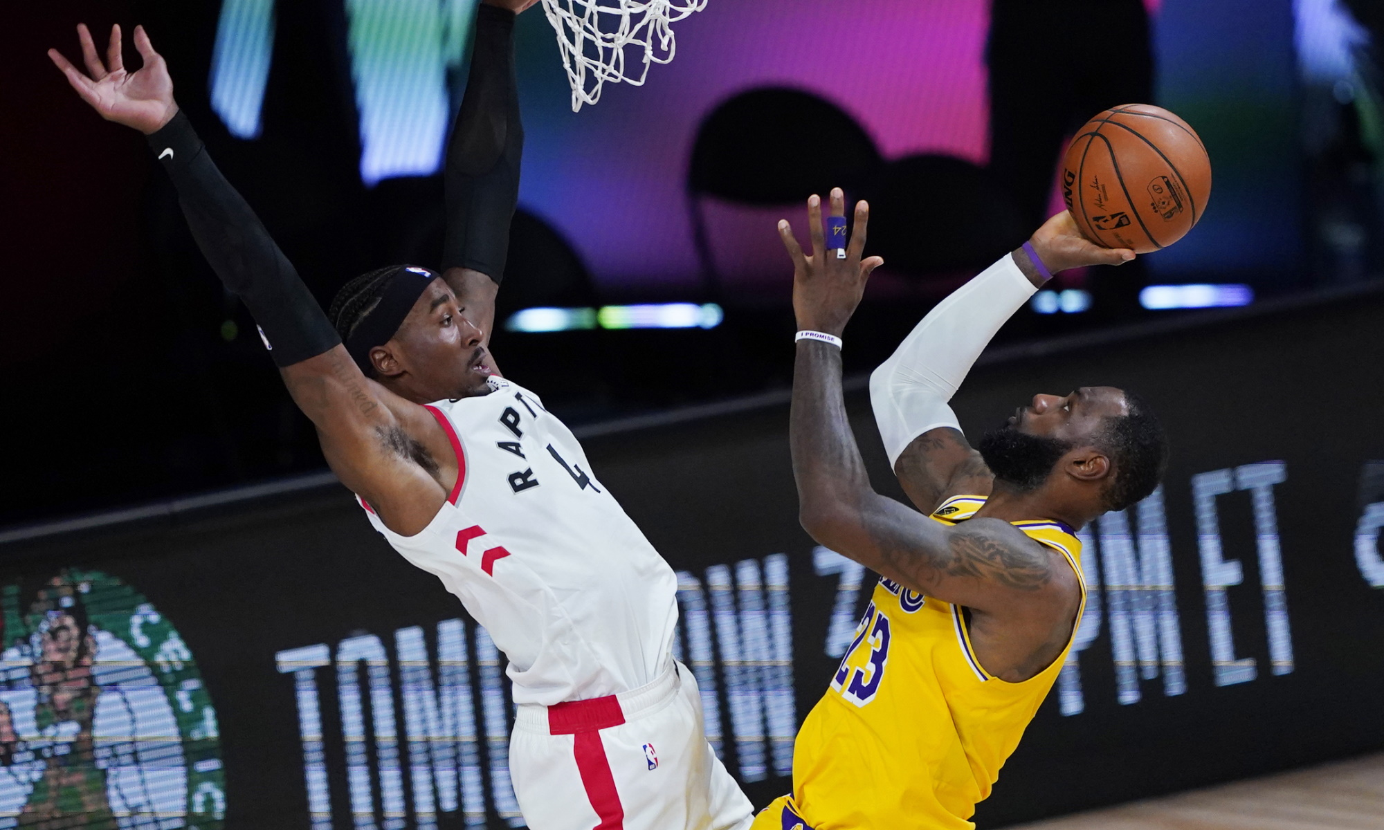 The Lakers' LeBron James reacts after a play against the Raptors during the second half Aug. 1, 2020. The Lakers' LeBron James reacts after a play against the Raptors during the second half. He finished with 20 points (Ashley Landis / Associated Press)